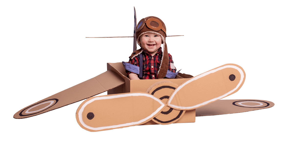 baby in a cardboard plane